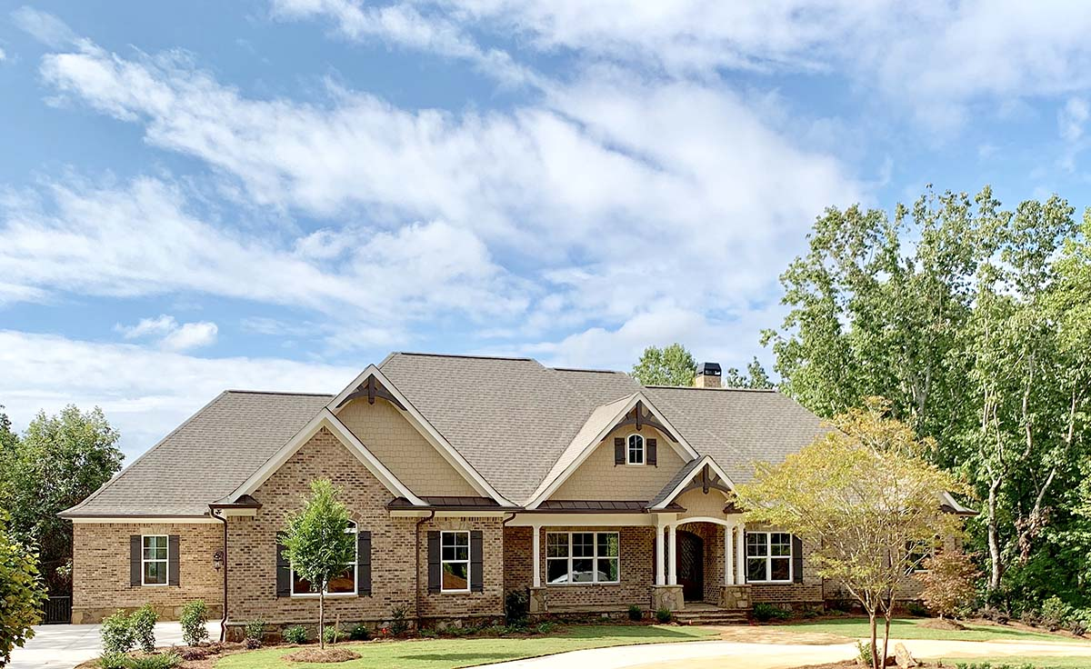 Craftsman, Ranch, Tudor House Plan 52021 with 4 Beds, 5 Baths, 3 Car Garage Picture 1